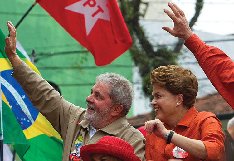 Brazil's President Luiz Inacio Lula da Silva, left, and Workers Party presidential candidate Dilma Rousseff wave to supporters during a campaign rally in Sao Bernardo do Campo, outskirts of Sao Paulo, Brazil, Saturday, Oct. 2, 2010. Brazil will hold general elections on Oct. 3. (AP Photo/Andre Penner)